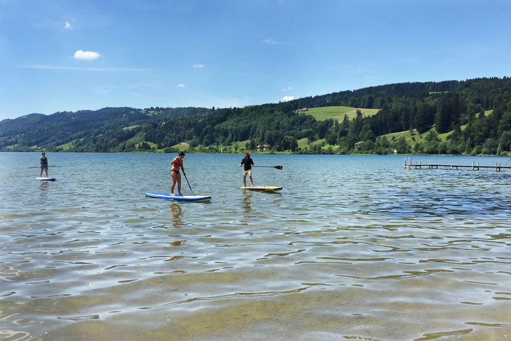 Stand-Up-Paddling at the Alpsee near Immenstadt